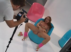 Simmering redhead Silvia Saint masturbates be advantageous to a photographer