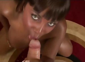 Hot coal-black belle dicksucking coupled with facial